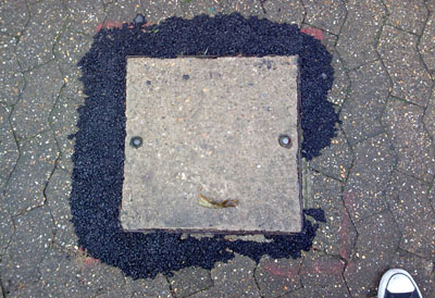Afro manhole cover
